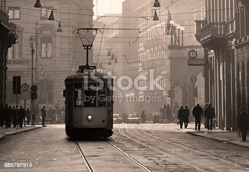 Historical tram in the city center of Milan, Italy, in brown sepia tone