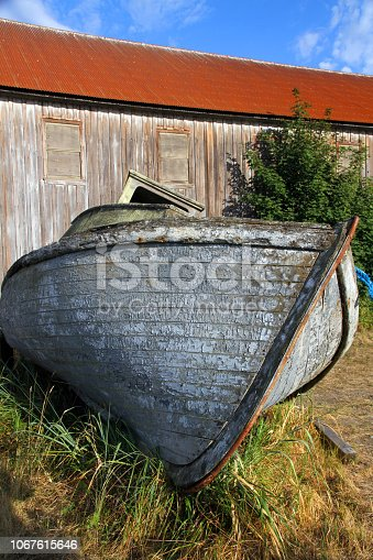 The hull of an abandoned boat in Washington State.