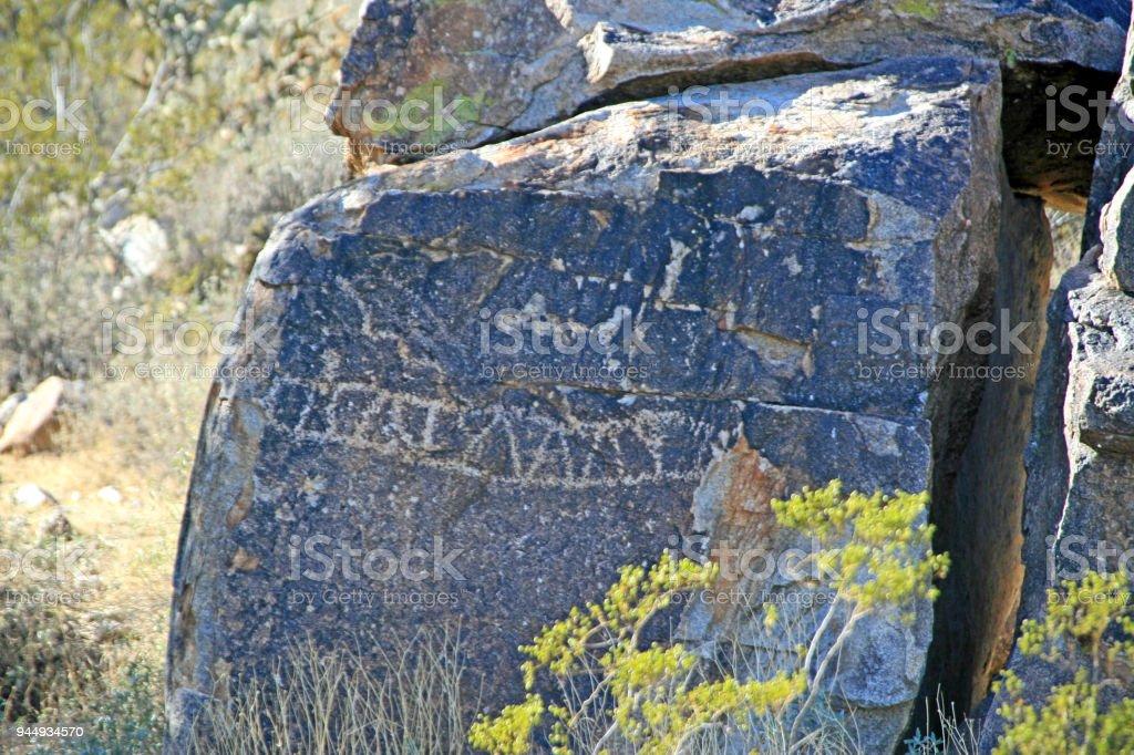 HIstorical tribal petroglyph drawing Nevada desert stock photo