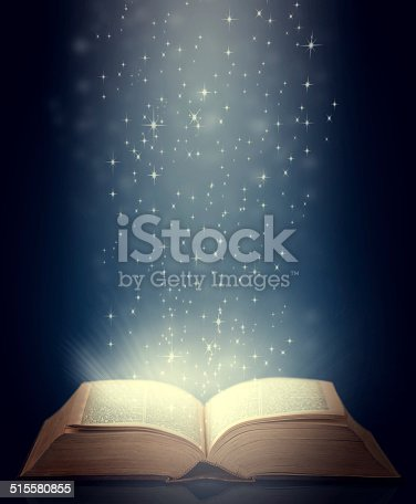 An glowing antique book against a blue background