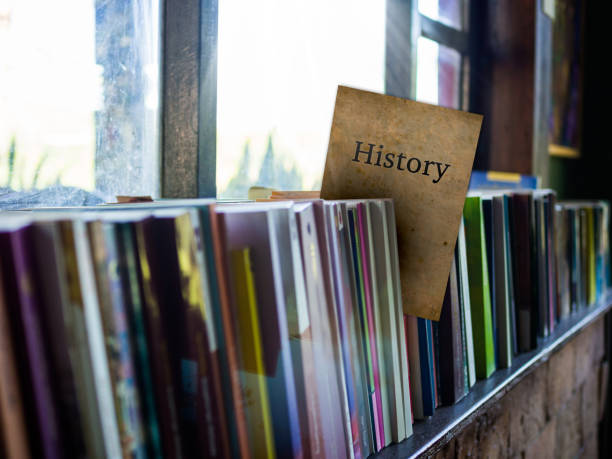 History on book cover on bookshelf, education concept stock photo
