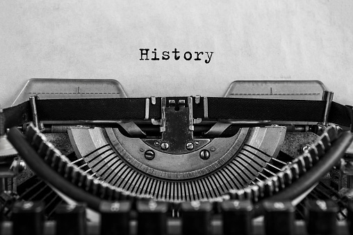 History typed on an vintage typewriter, old paper. close-up