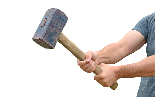 istock Hit and destroy concept. Strong man's hands with a sledgehammer isolated on white. 1166804998