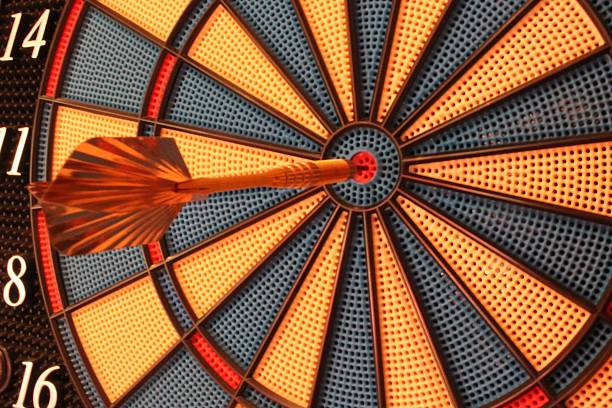 Hit in the center of a dartboard stock photo