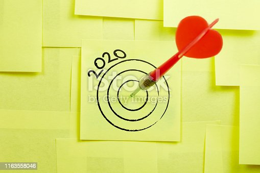 istock Hit The 2020 Target In Darts Game Concept On The Sticky Note Papers 1163558046