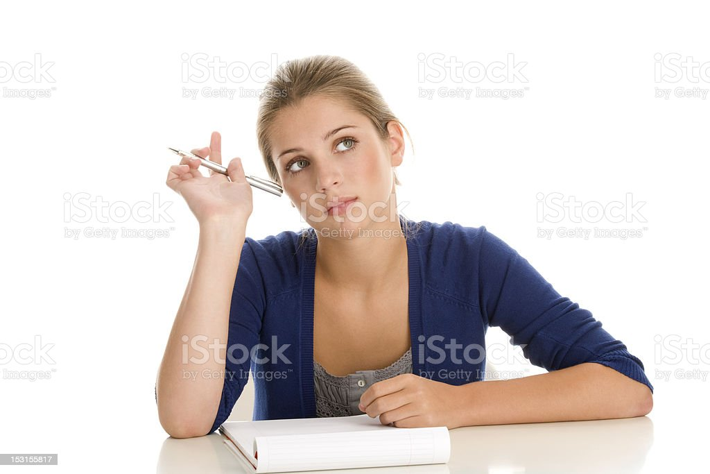 Hitch school woman taking notes, looking off into space royalty-free stock photo