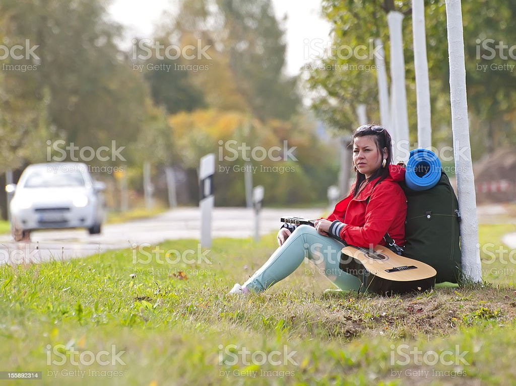 Hitchhiker with guitar royalty-free stock photo
