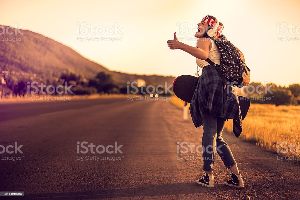 Hitchhiking hipster stock photo