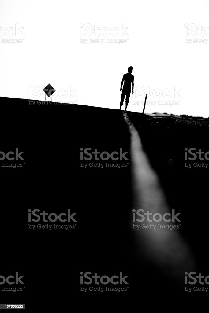 Hitchhiking in the desert royalty-free stock photo