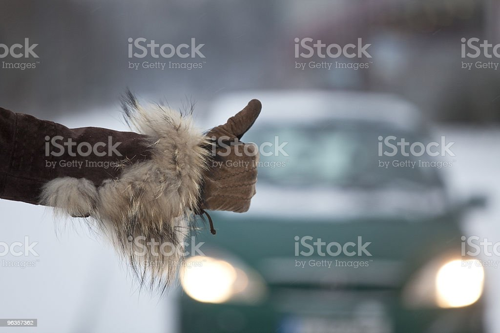 hitchhiking in winter royalty-free stock photo