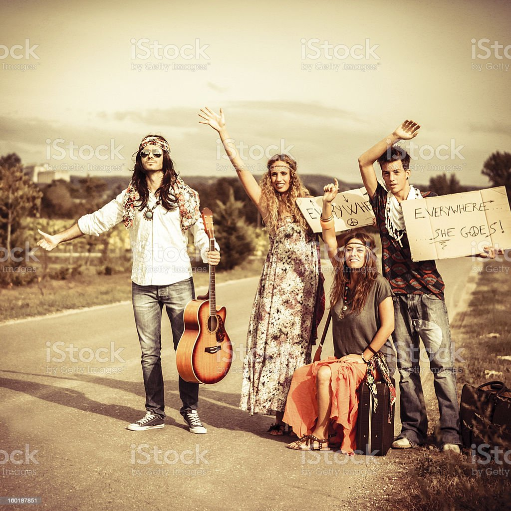 Hitchiking Young Hippies, Vintage Mood royalty-free stock photo