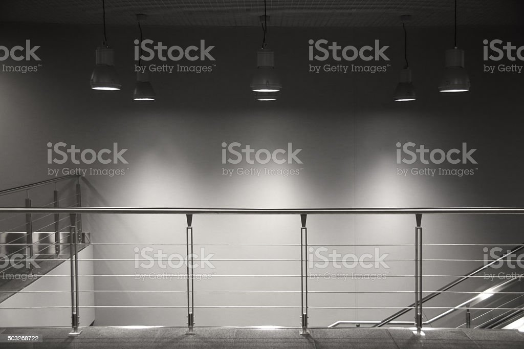Hi-tech steel balustrade, elements of stairs and spotlights stock photo