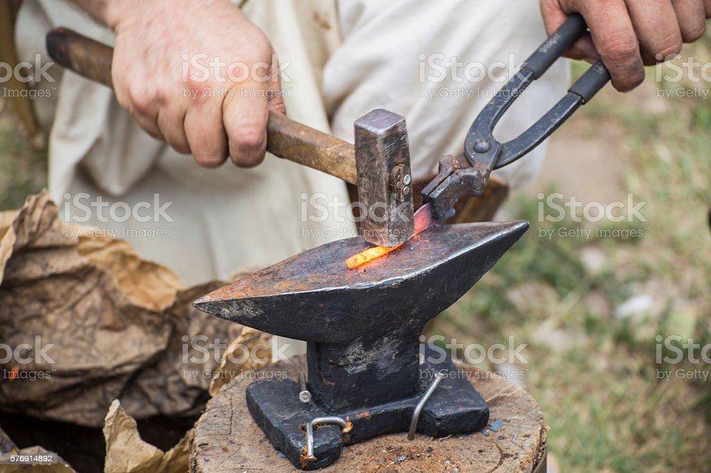 Hiting melting metal stock photo