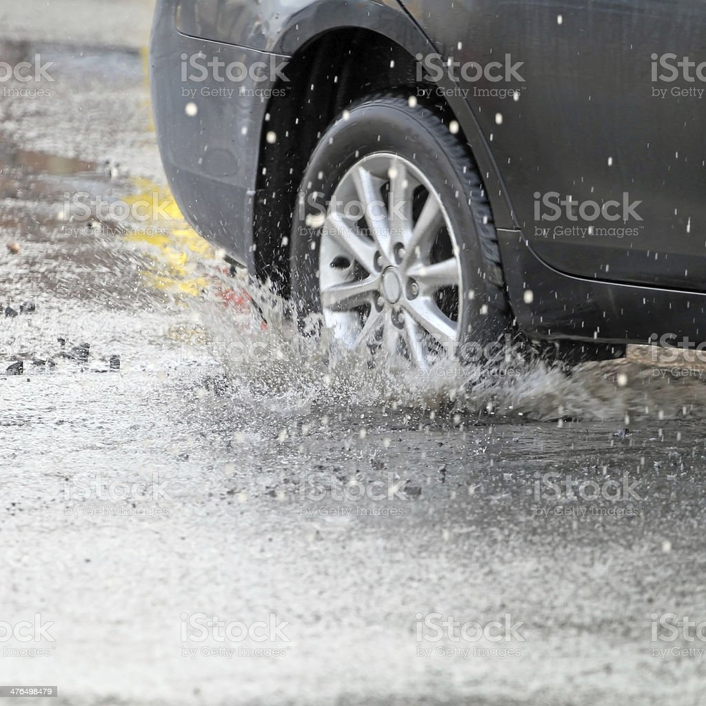 Hitting A Pot Hole stock photo