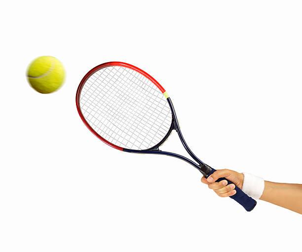 hitting a tennis ball - Photo