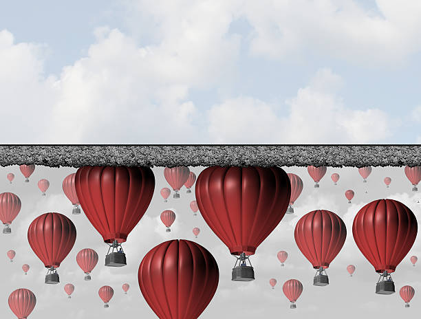 Hitting A wall Hitting a wall and reach the limit or ceiling as a business concept for restricted opportunity and closed economic barrier to succeed as a group of air balloons trapped by a thick roof. debt ceiling stock pictures, royalty-free photos & images