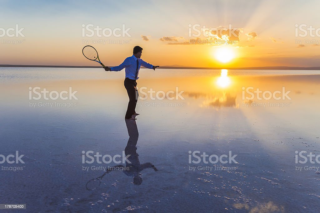 Hitting forehand against the sunset royalty-free stock photo