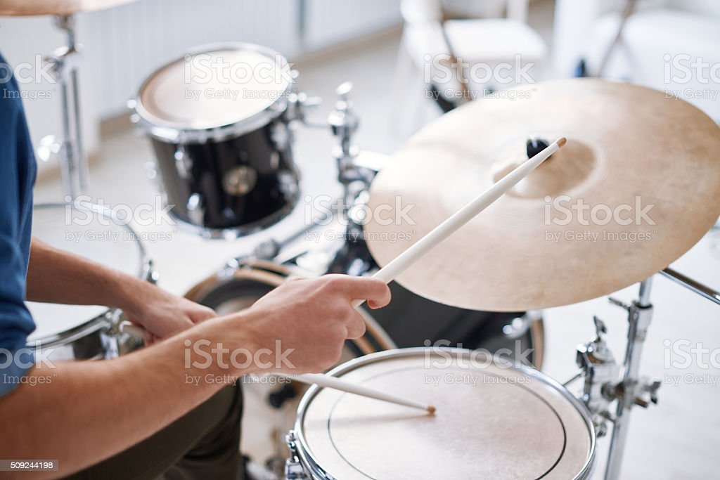 Hitting on drums stock photo