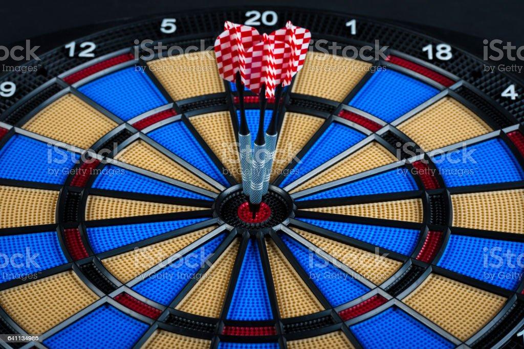 dart hitting the bulls eye on electronic dartboard