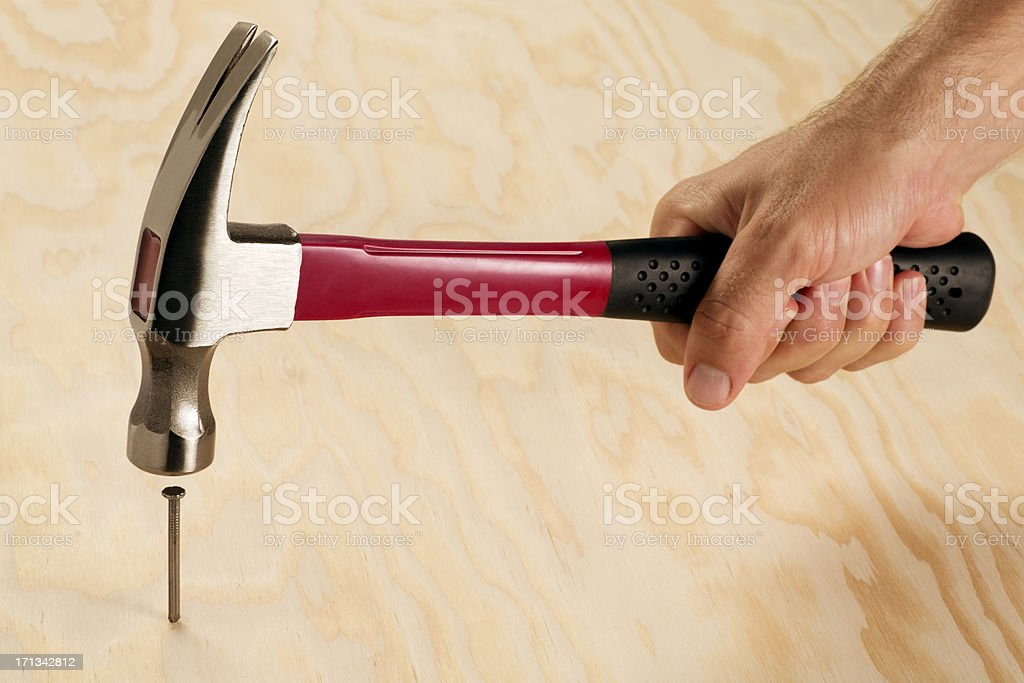 Hitting the Nail on a Head stock photo