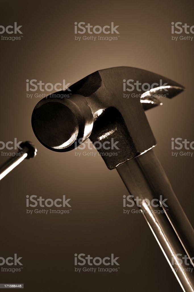 Hitting the Nail on a Head stock photo