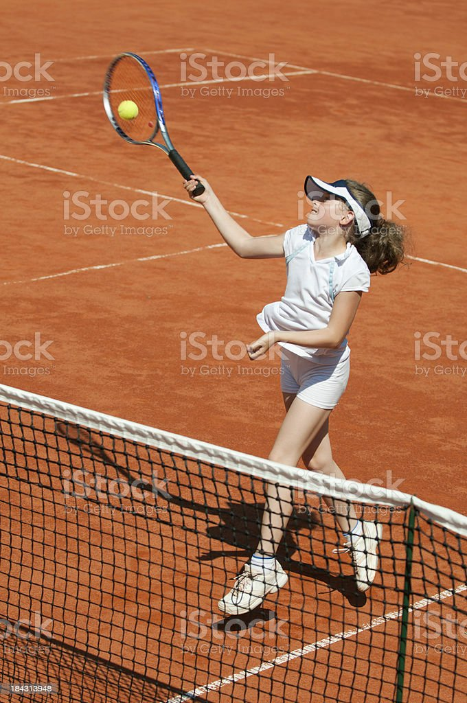 Hitting volley on the net stock photo