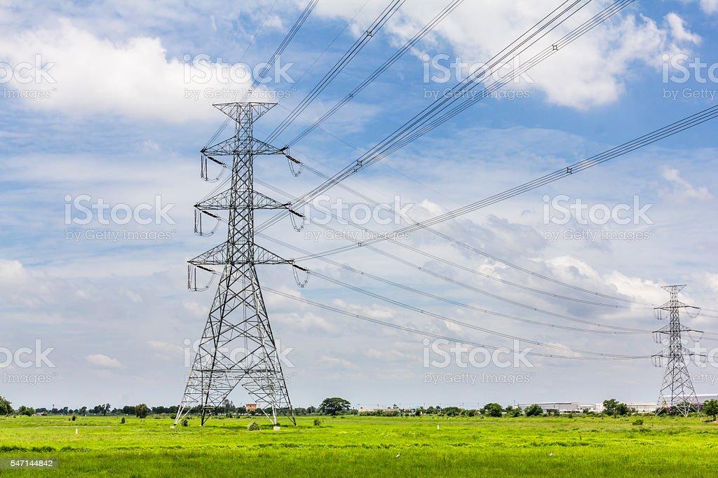 Hi-voltage electrical pylons against blue sky stock photo