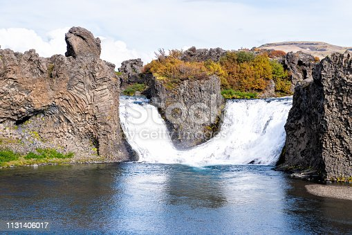 istock Hjalparfoss waterfall landscape of orange tree foliage in southern Iceland in autumn fall season closeup 1131406017