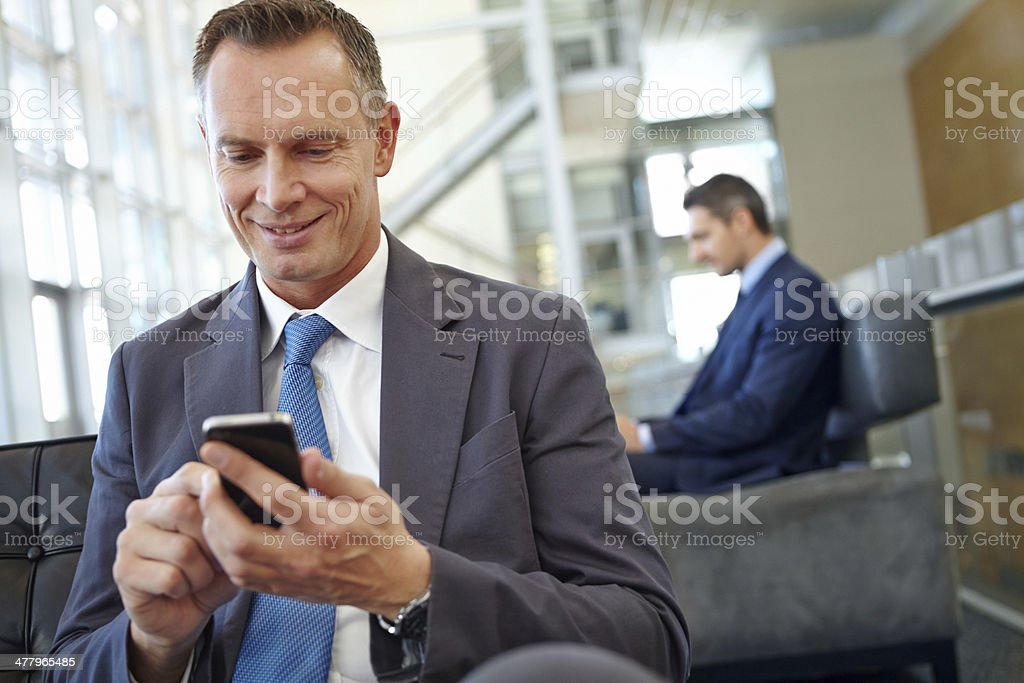 Hmm, let me just text this client back... royalty-free stock photo