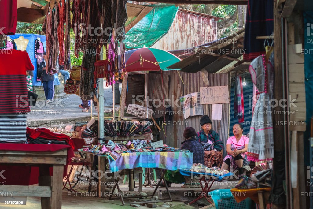 Hmong women selling clothes. Doi Pui hill tribe village, handicraft market of the ethnic minority of miao or maew people in Chianf Mai province, Northern Thailand stock photo
