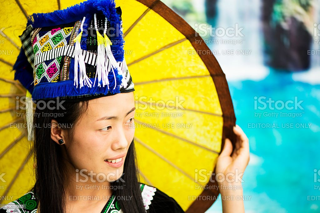 Hmong Young Woman with a Parasol stock photo