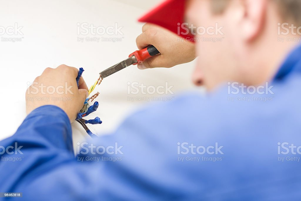 Hnadyman working with wires royalty-free stock photo
