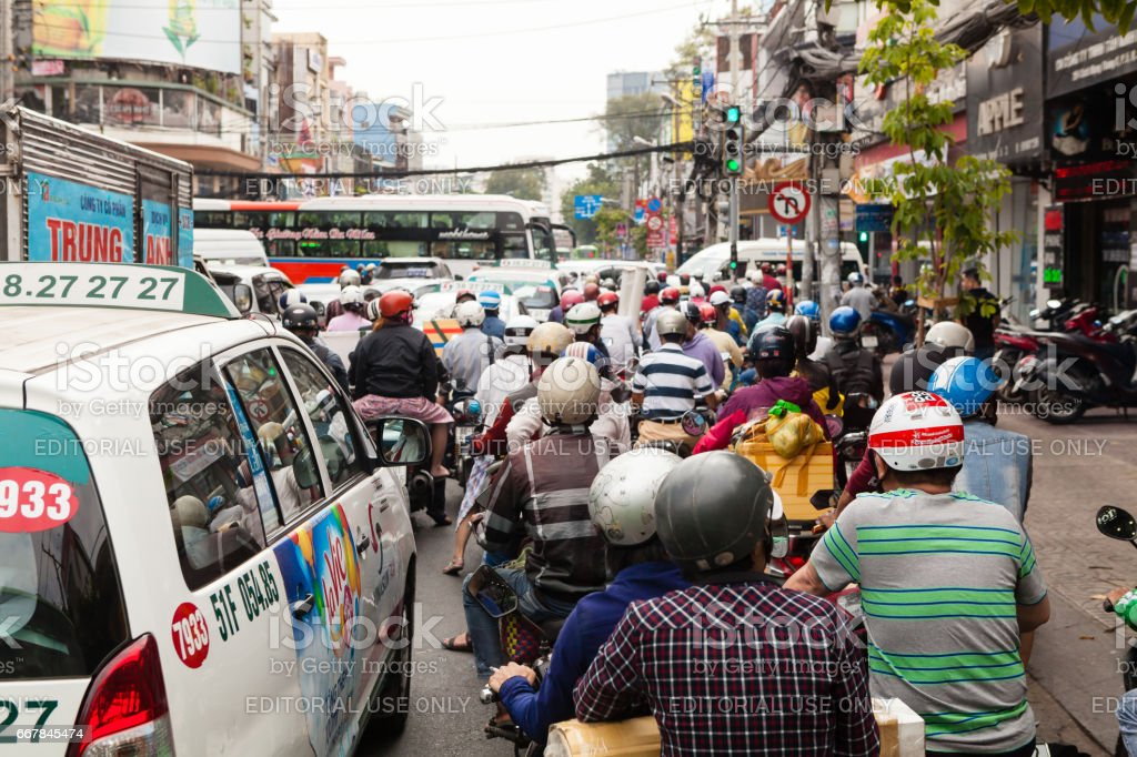 Ho Chi Minh City (Saigon), Vietnam - march 7 2017: heavy traffic on the street. Scooter is most popular mean of transport in Vietnam royalty-free stock photo