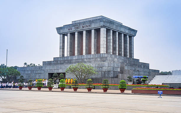 Ho Chi Minh Mausoleum - Hanoi, Vietnam The Ho Chi Minh Mausoleum holds the embalmed remains of Ho Chi Minh - this massive granite structure looms over Ba Dinh Square in Hanoi, Vietnam. viet cong stock pictures, royalty-free photos & images