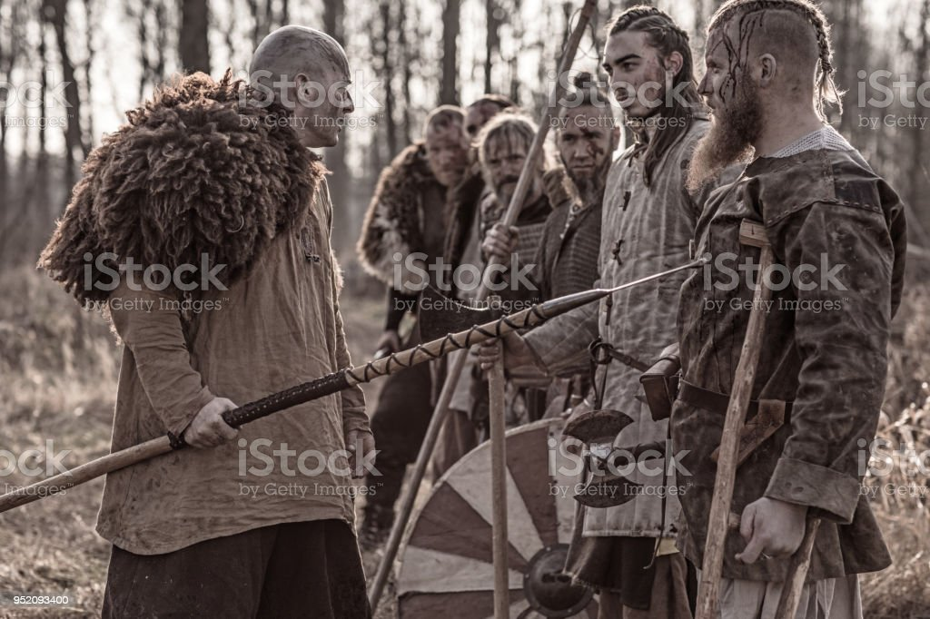 A Hoard Of Weapon Wielding Bloody Viking Warriors On A Winter Battlefield Forest Stock Photo Download Image Now