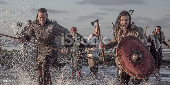 istock A hoard of Weapon wielding viking warriors fighting in a battlefield scene in the sea 1062171118