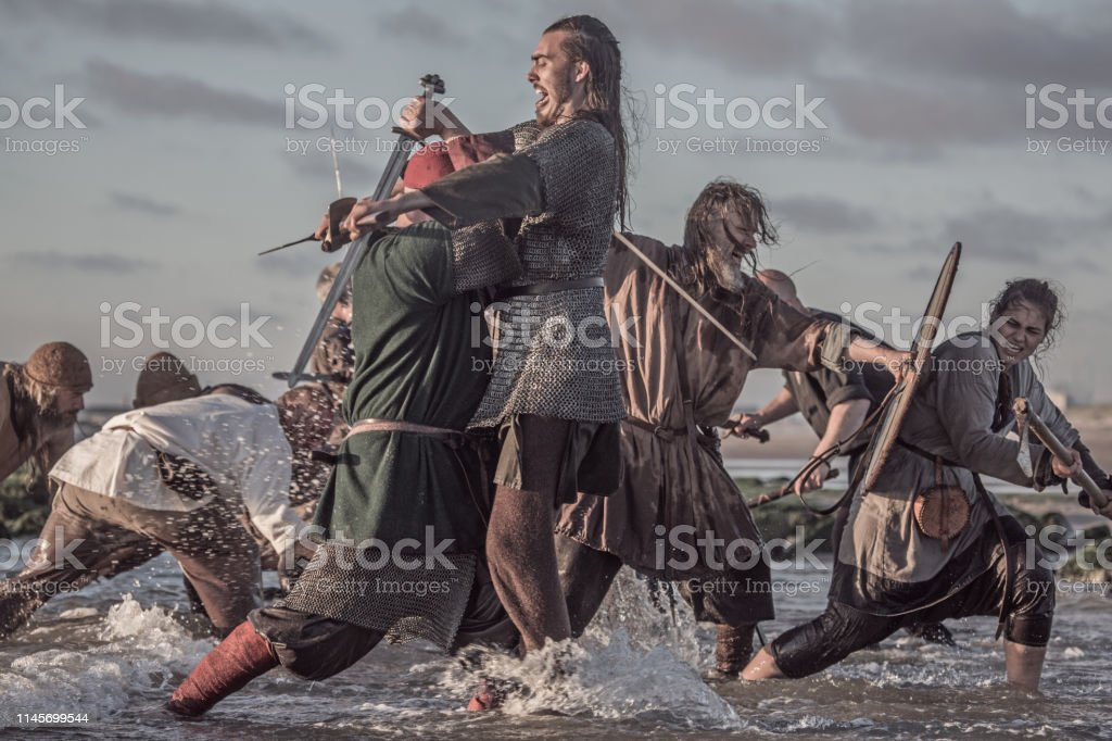 A Hoard Of Weapon Wielding Viking Warriors Fighting In A Battlefield Scene In The Sea Stock Photo Download Image Now