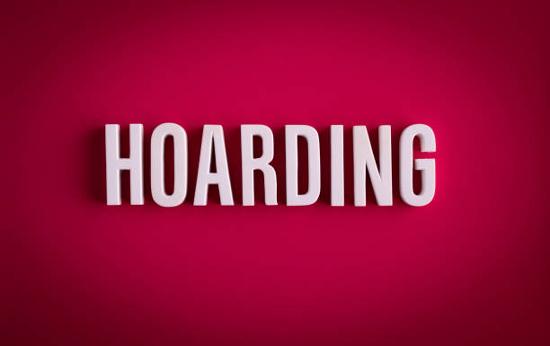 Hoarding sign lettering on a red colored background stock photo