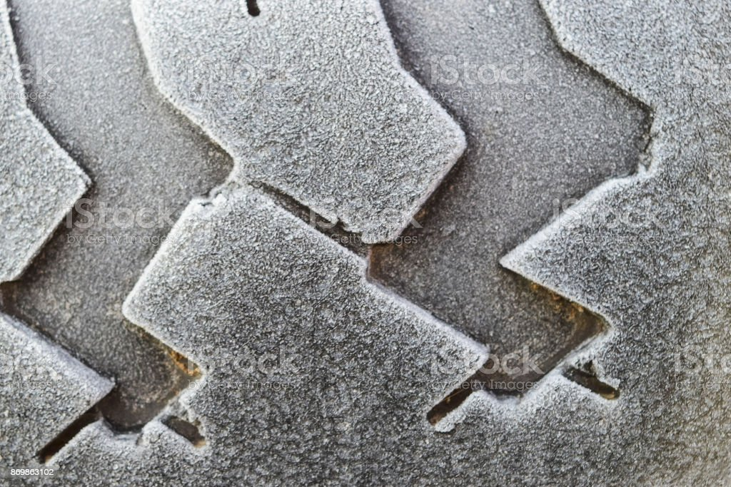 Hoarfrost on a rubber tire wheel stock photo