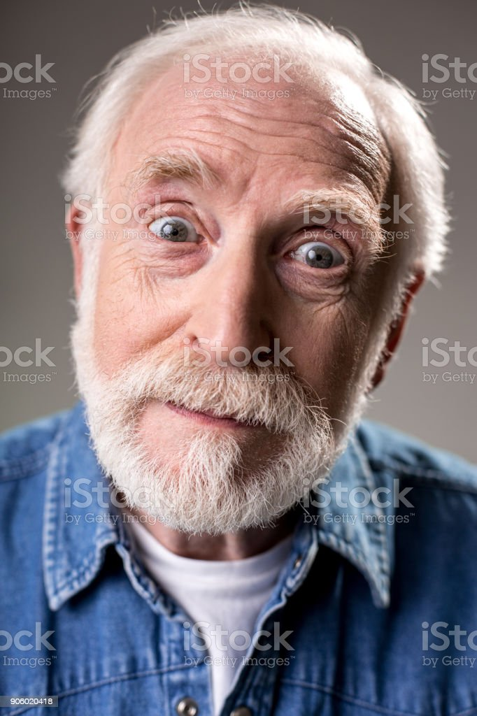 Hoary man with astonished face stock photo