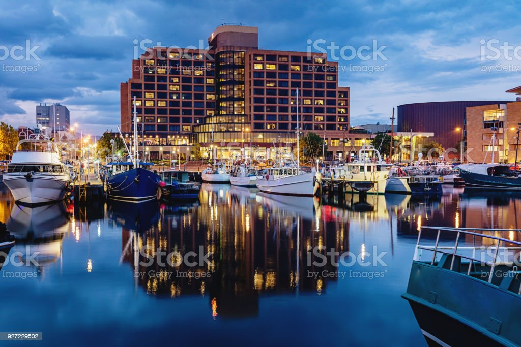 Hobart Marina at Dusk Tasmania Hobart Marina at dusk with reflections in the calm water and Hobart skyline in the background. Hobart, Tasmania, Australia. Australia Stock Photo