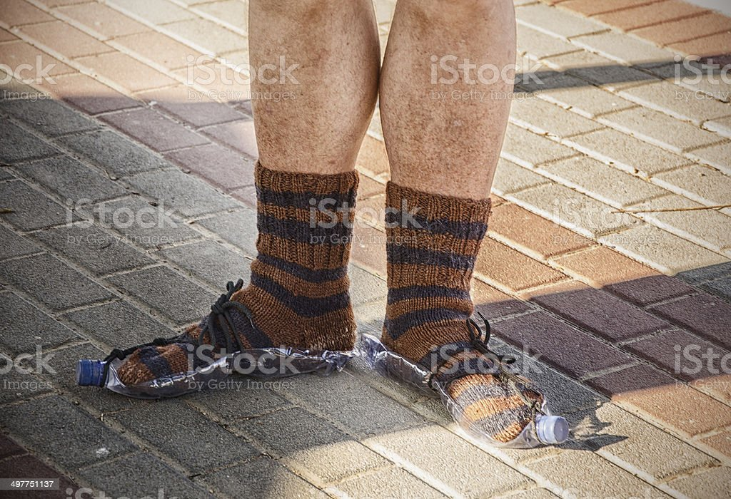 Hobo feet wearing knitted socks royalty-free stock photo