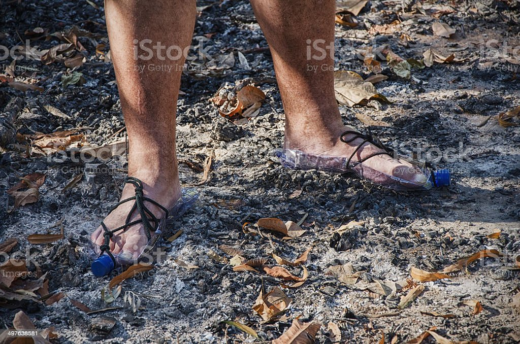Hobo standing in bottle sandals on wood ashes royalty-free stock photo