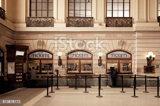 Hoboken, New Jersey, USA - April 11, 2016: Commuters purchase tickets inside the Hoboken Terminal waiting room