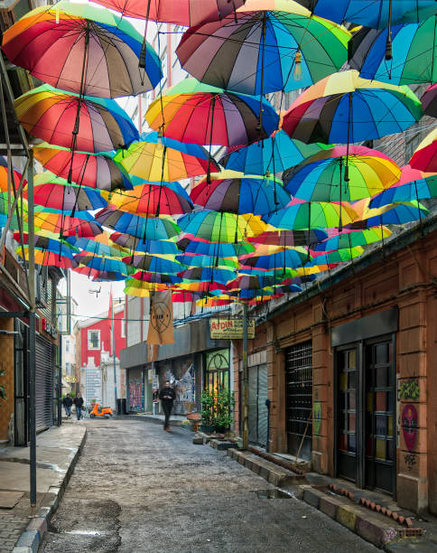 hoca tahsin street at karakoy district, istanbul, turkey, decorated with colorful umbrellas - каракёй стамбул стоковые фото и изображения