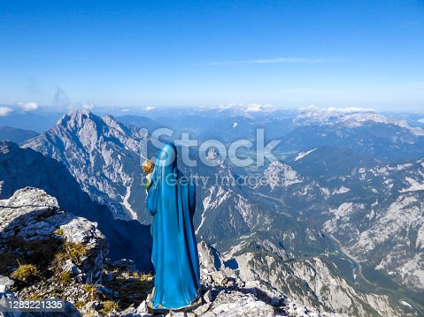 istock Hochtor - A statue of St Mary with Baby Jeasus wathing the Alpine valley from the mountain peak 1283221335