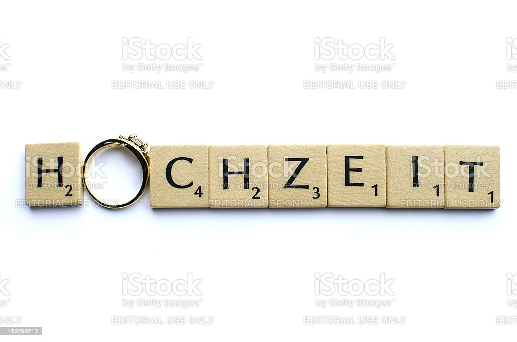 'Hochzeit' written with Scrabble tiles and an engagement ring royalty-free stock photo