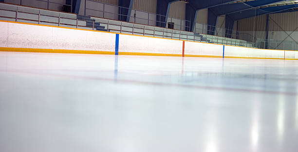 Hockey Arena at Ice Level A recently cleaned and flooded small town hockey rink. ice rink stock pictures, royalty-free photos & images