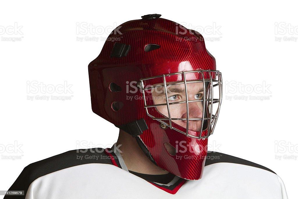 Hockey goalie looks to side stock photo