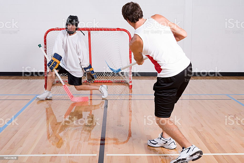 Hockey goalkeeper making a save 免版稅 stock photo